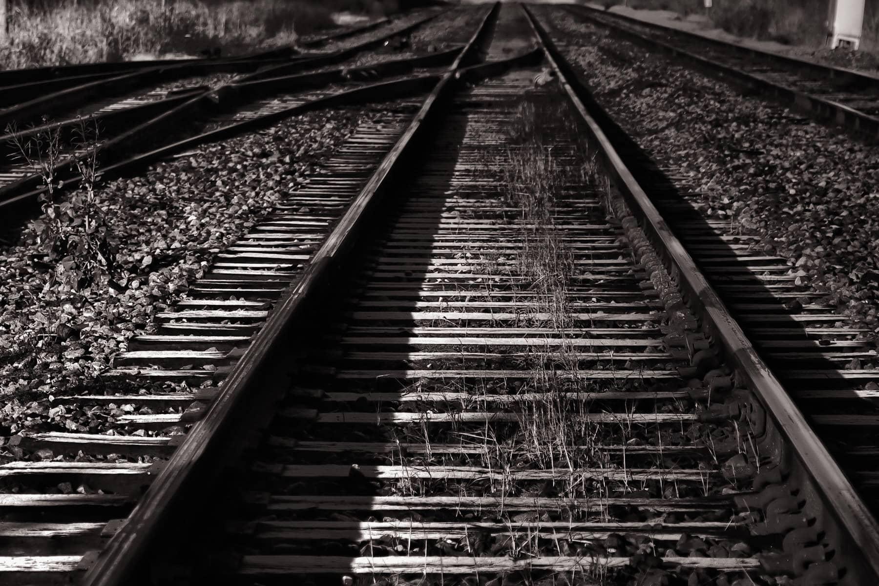 Train tracks lead into the distance in West Dallas.