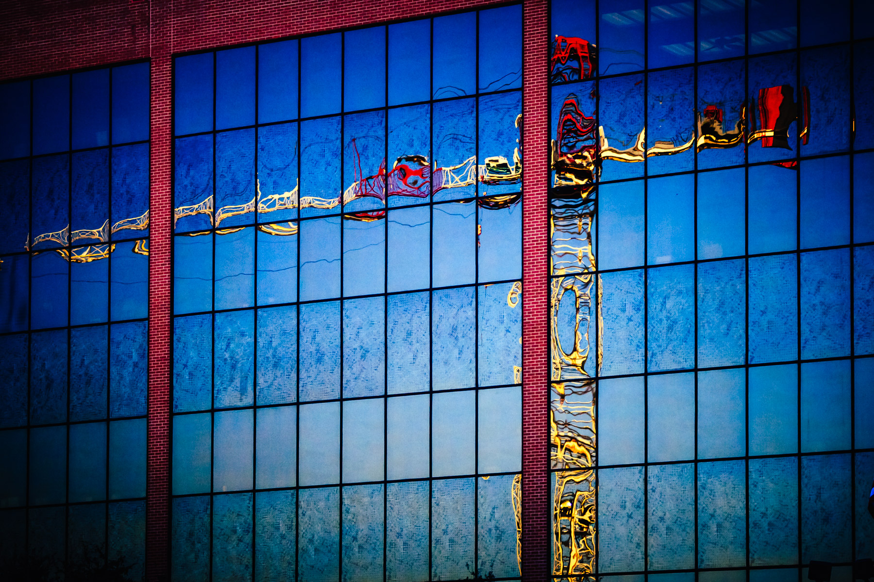 A tower crane reflected in the windows of an adjacent building in Downtown Fort Worth, Texas.