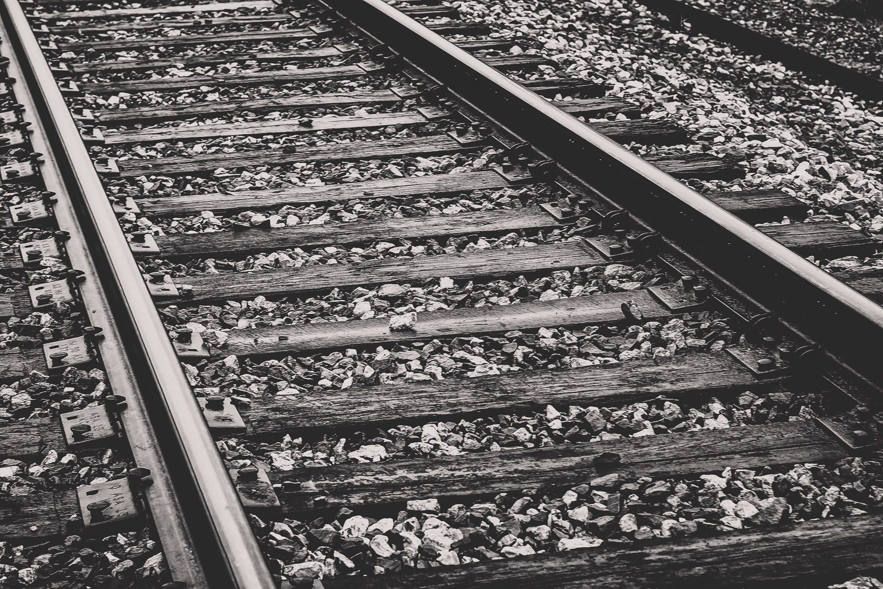 Railroad tracks and their rocky ballast in Jefferson, Texas.