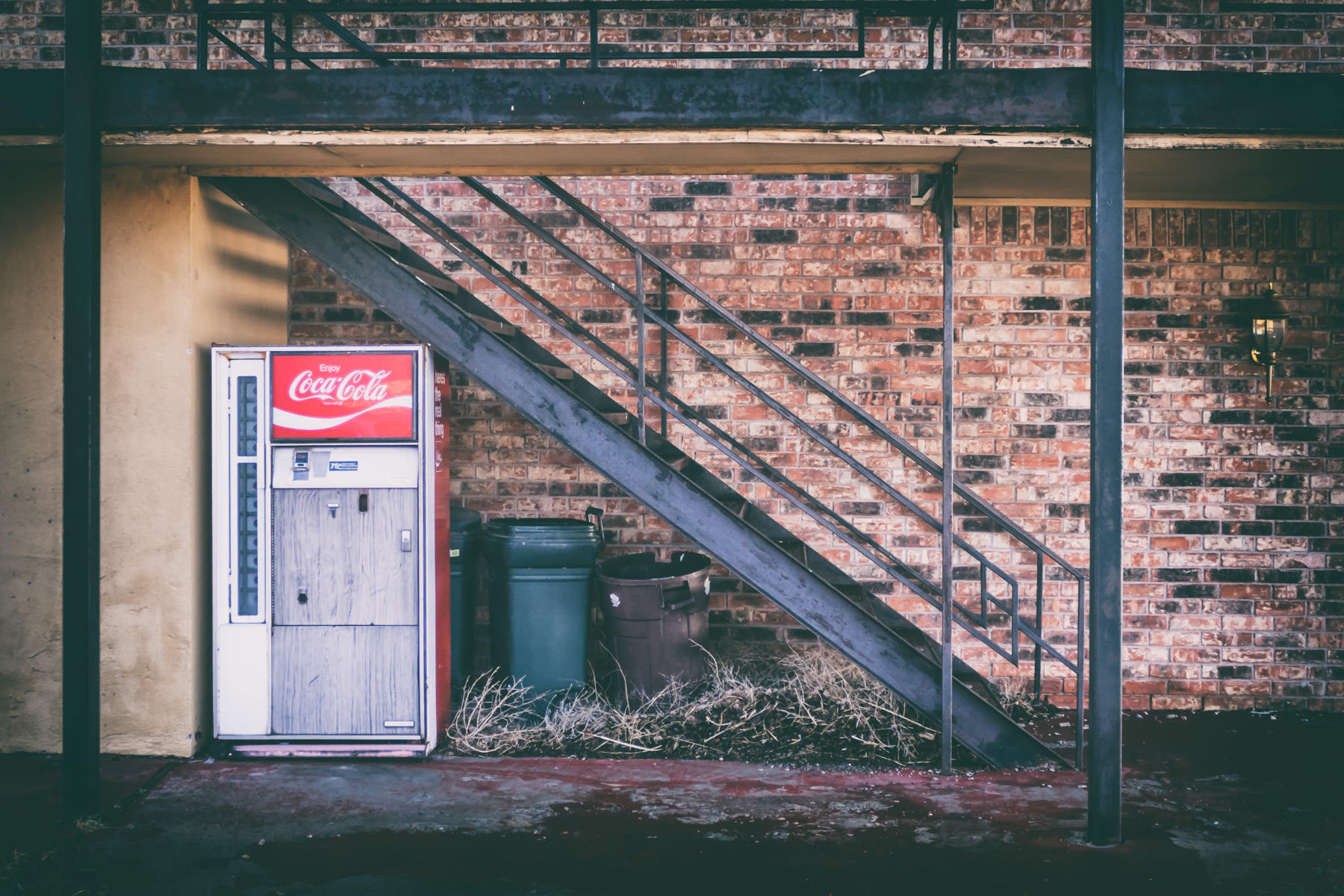 An old Coca-Cola vending machine outside a roadside motel in Adrian, Texas.