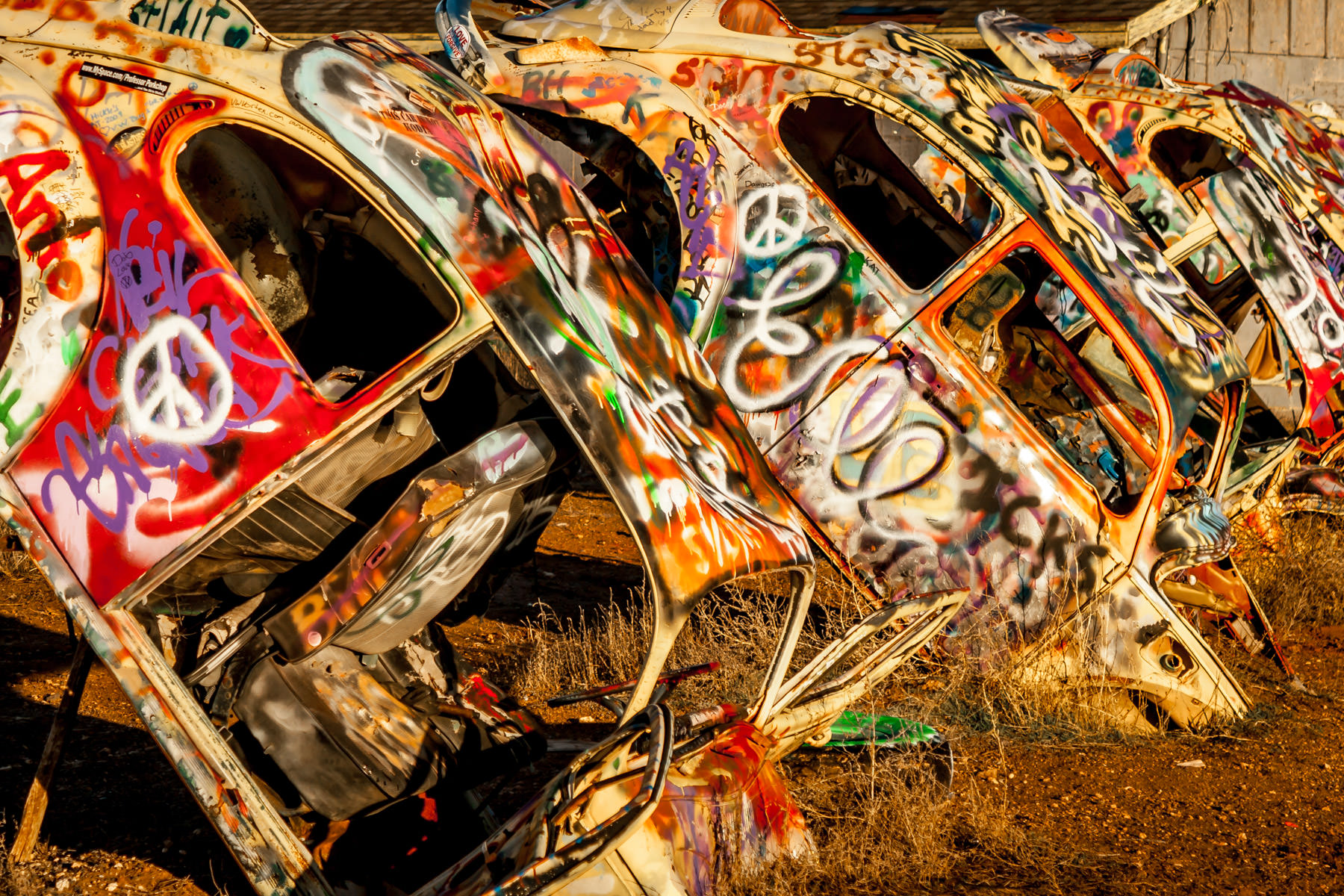 Five Volkswagen Beetles buried in the ground nose first at Slug Bug Ranch in Conway, Texas.