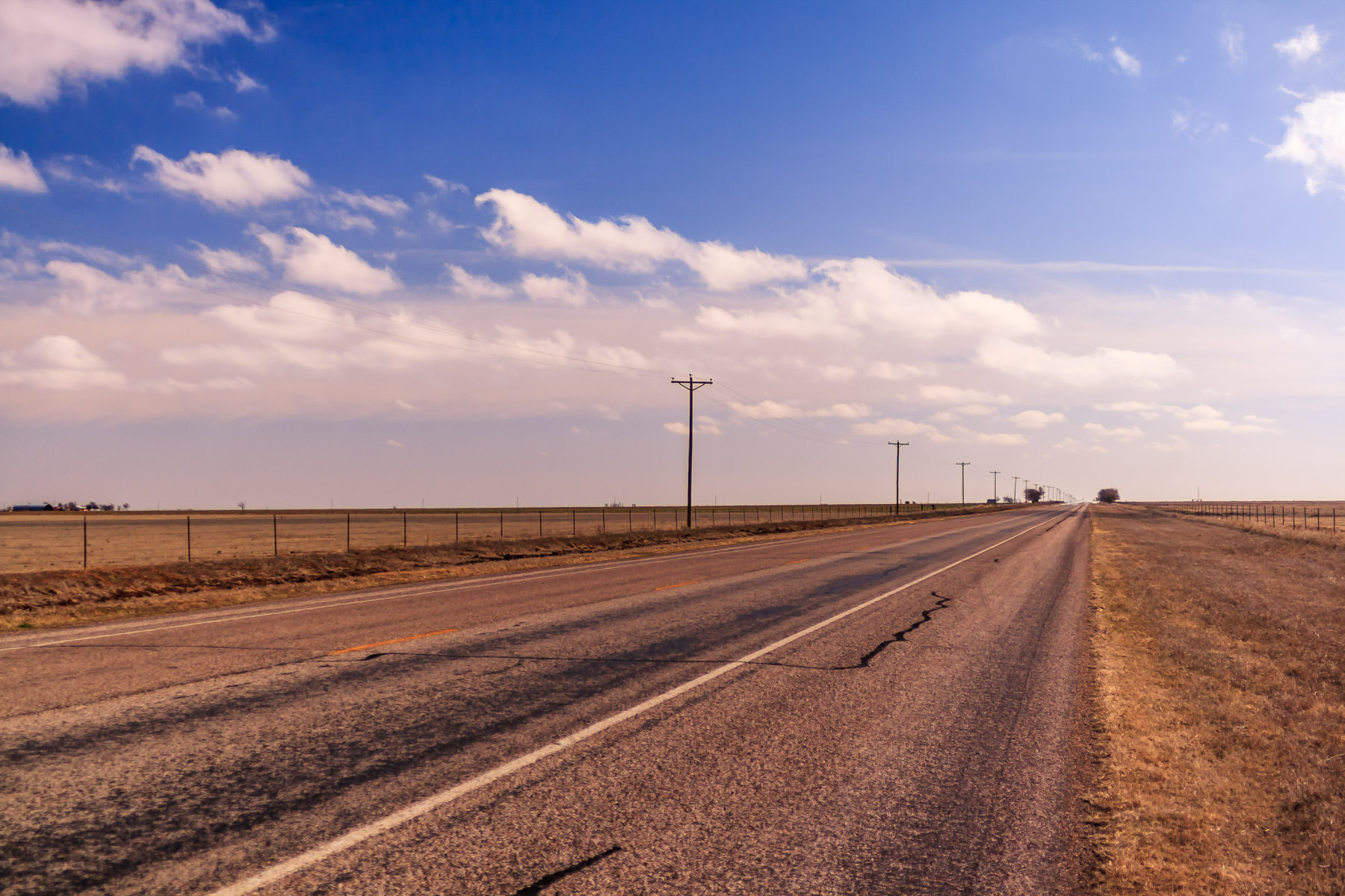 A road leads to the distant horizon in the Texas Panhandle near Canyon.