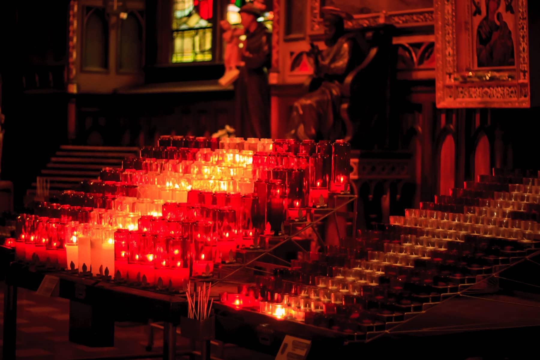 Votive candles at La basilique Notre-Dame de Montréal.