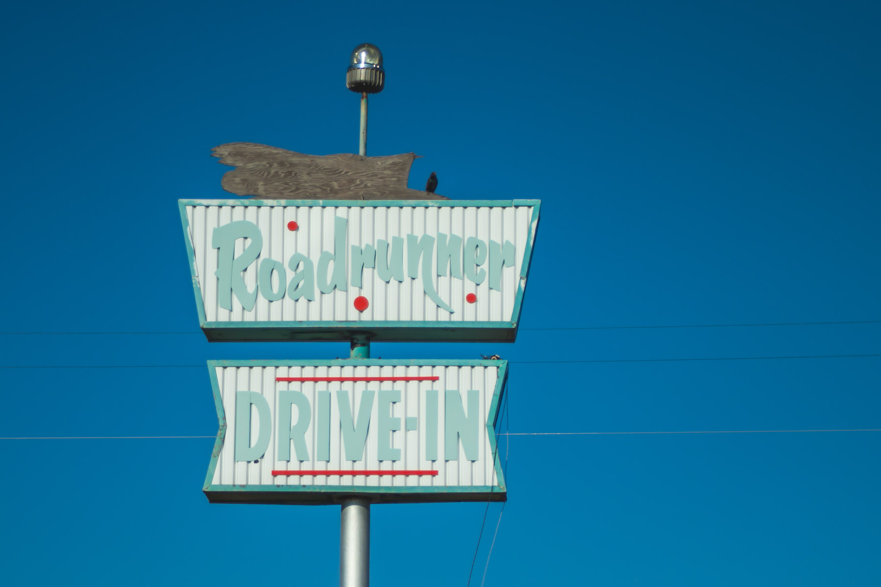 A dilapidated sign for the Roadrunner Drive-In spotted in Tucumcari, New Mexico.