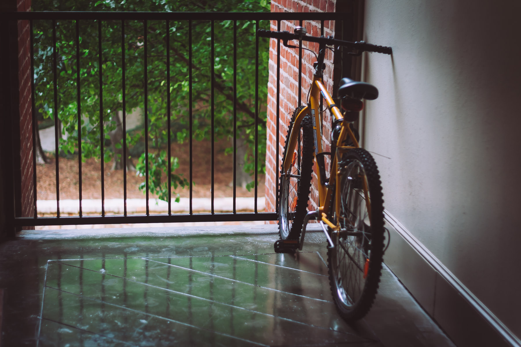 A bike overlooks Addison, Texas' Bosque Park from a second-story breezeway in an adjacent building.