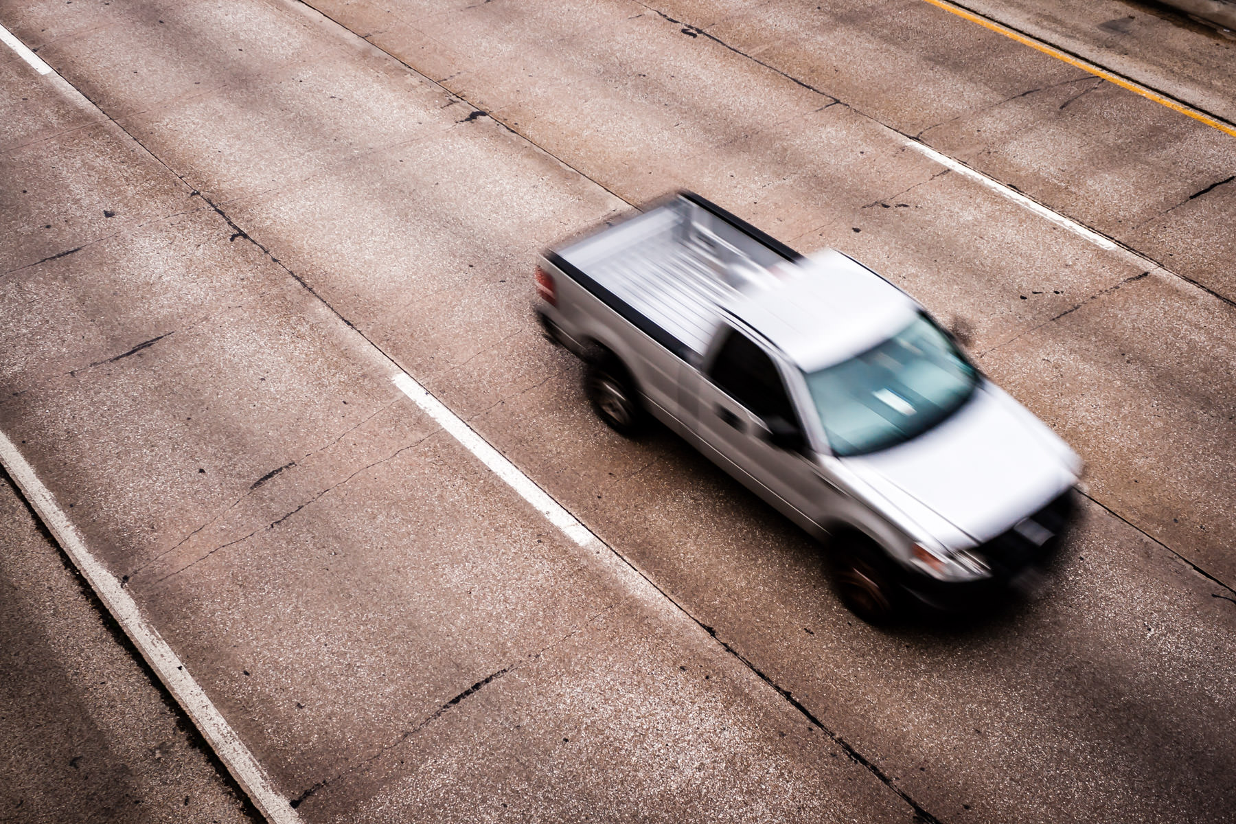 A pickup truck speeds by on Dallas' Woodall Rogers Freeway.