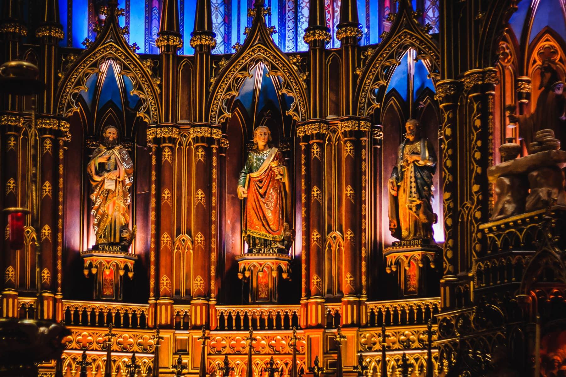 Statues of saints at la basilique Notre-Dame de Montréal.