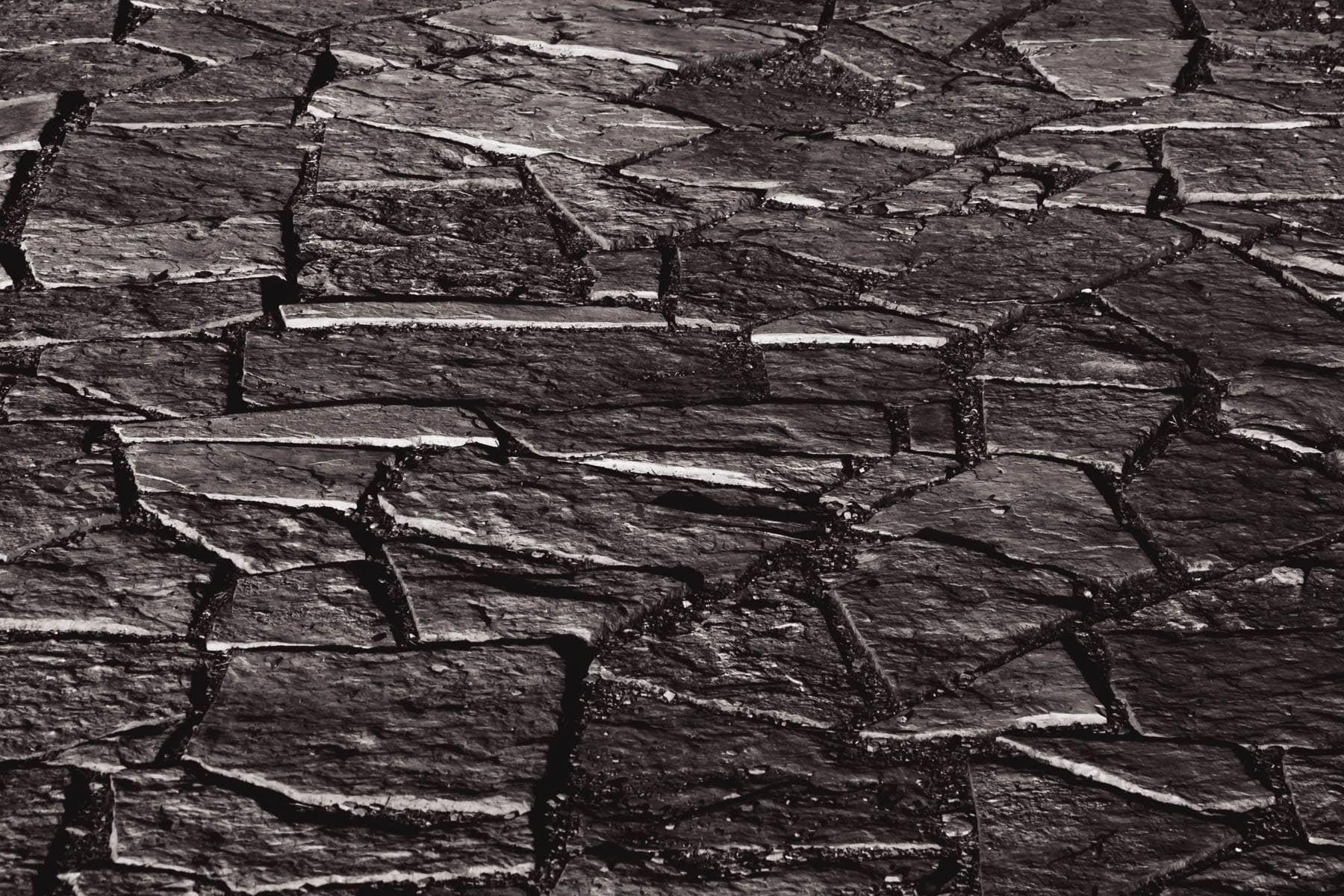 Rough-hewn flagstones stones form a sidewalk in Addison Circle Park, Addison, Texas.