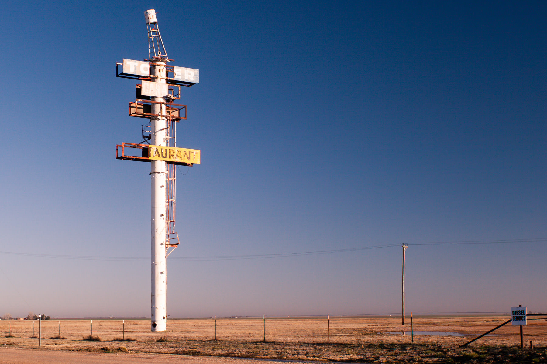 The decaying, abandoned sign of a long-gone truck stop in Britten, Texas.