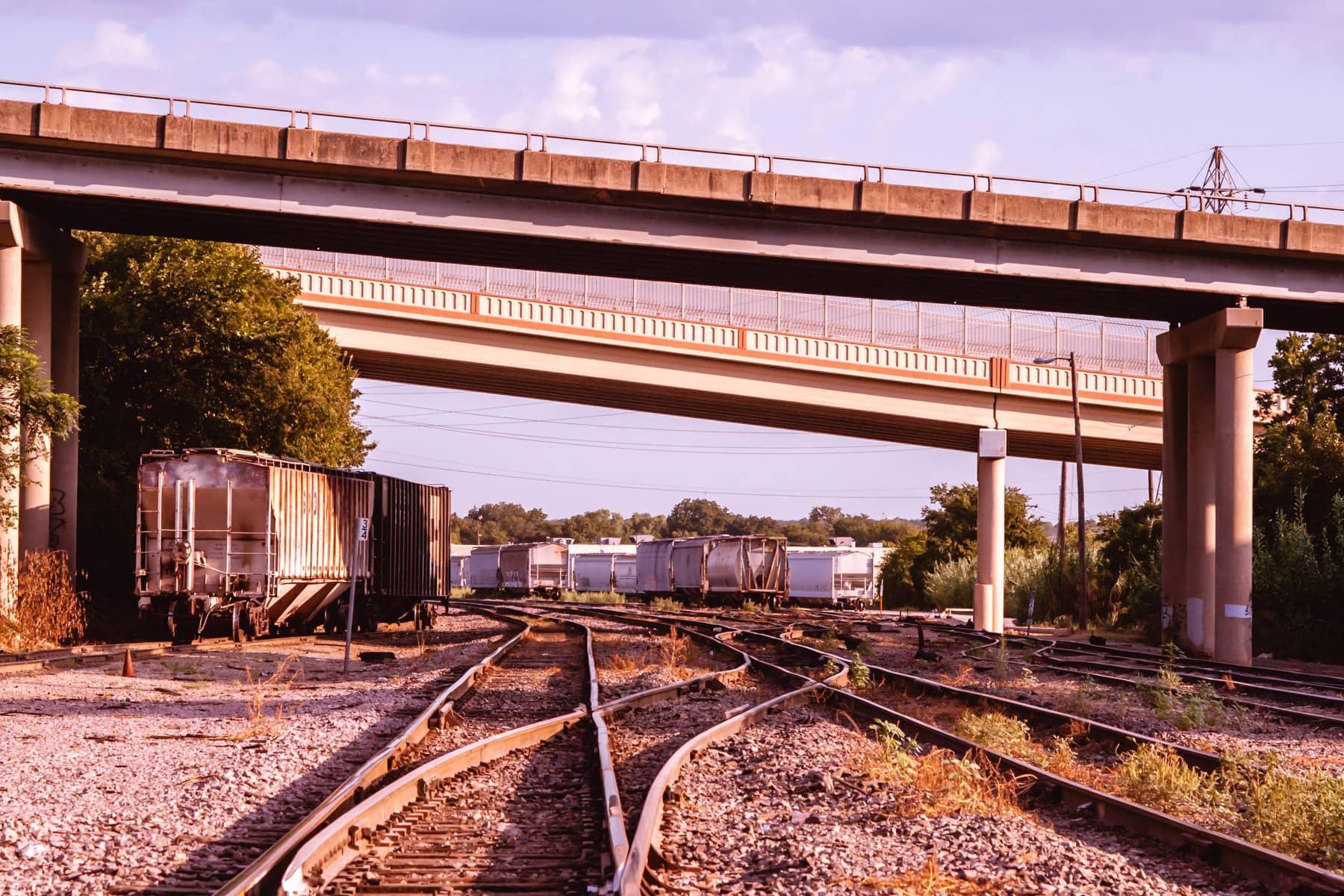 Rail cars sit idle underneath the Weatherford Street and Belknap Street bridges in Fort Worth, Texas.