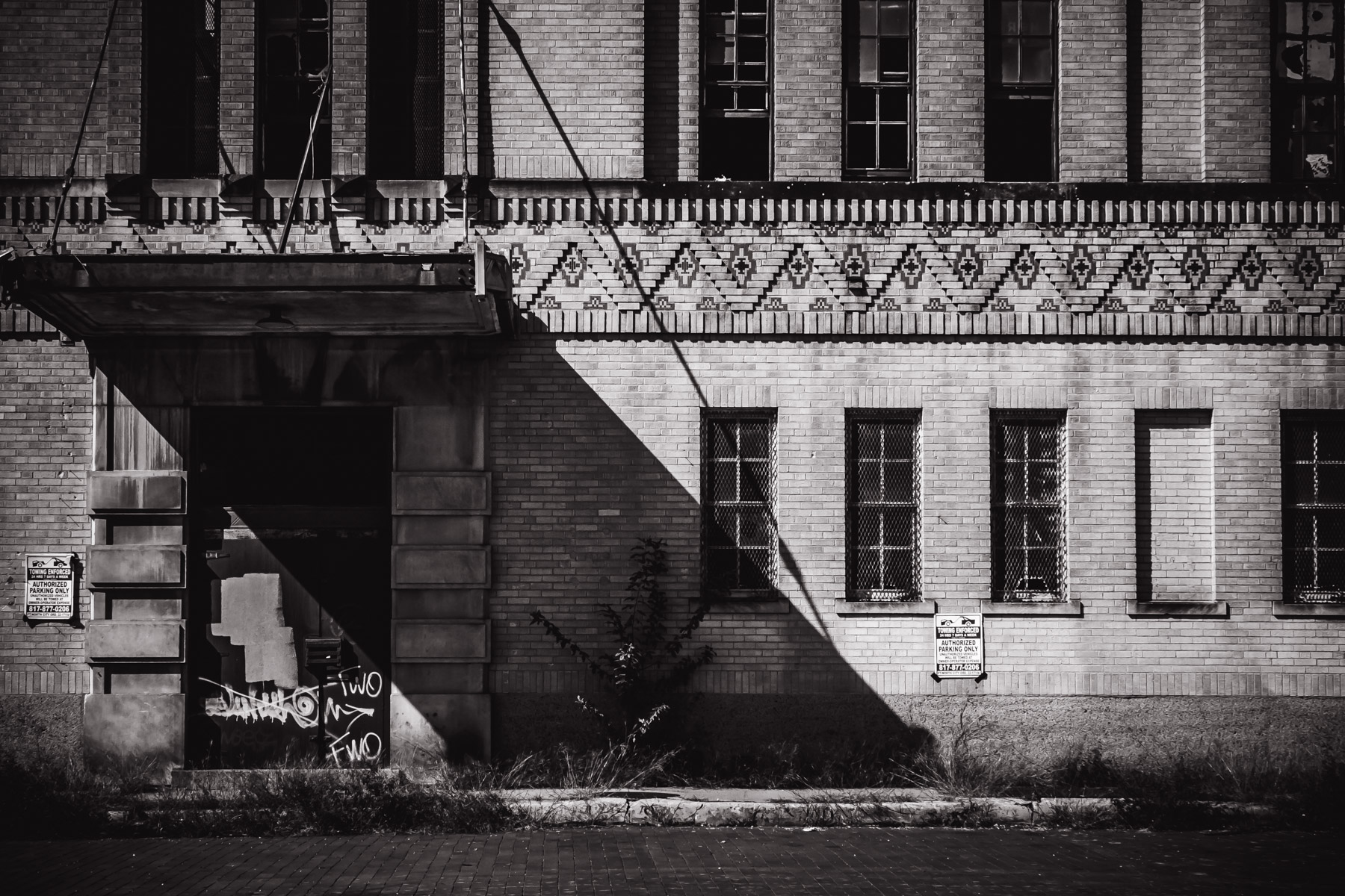 An abandoned building's entrance decays south of Downtown Fort Worth.