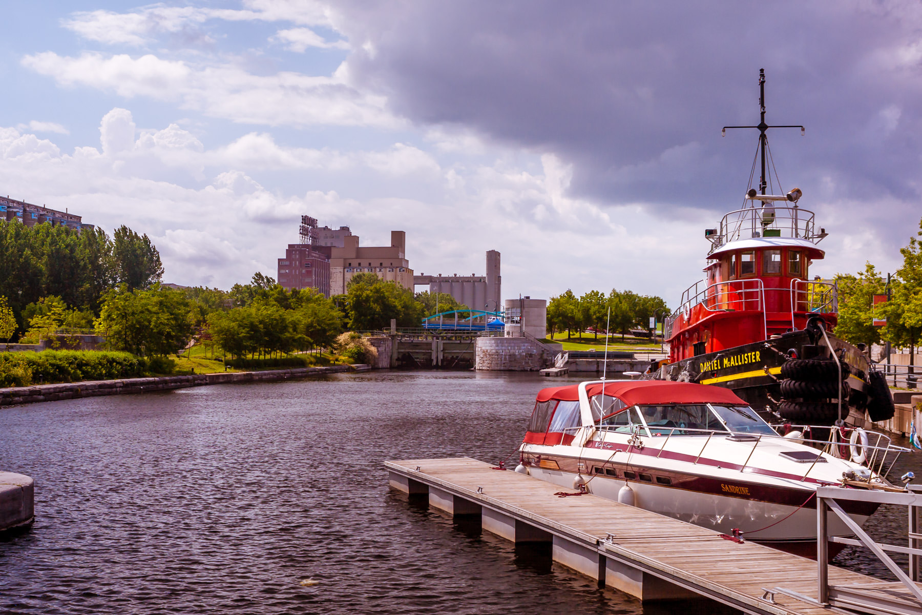 Boats docked along Montréal's Canal de Lachine as storm clouds roll in.