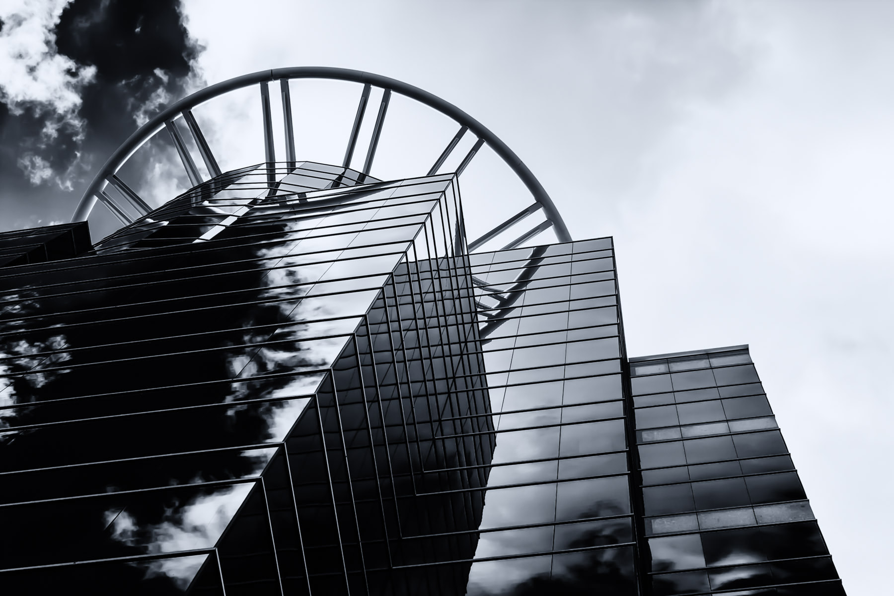 An office tower along the Dallas North Tollway in Addison, Texas, reflects the late summer clouds.