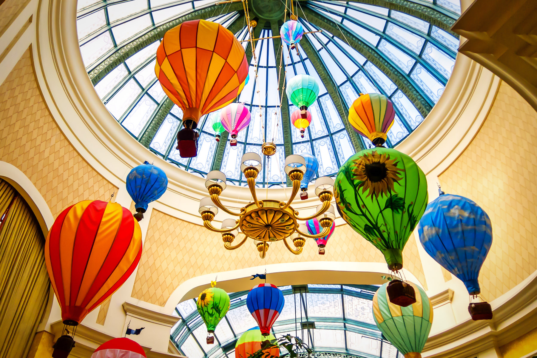 Decorative balloons hang from an atrium's roof in the Bellagio, Las Vegas.