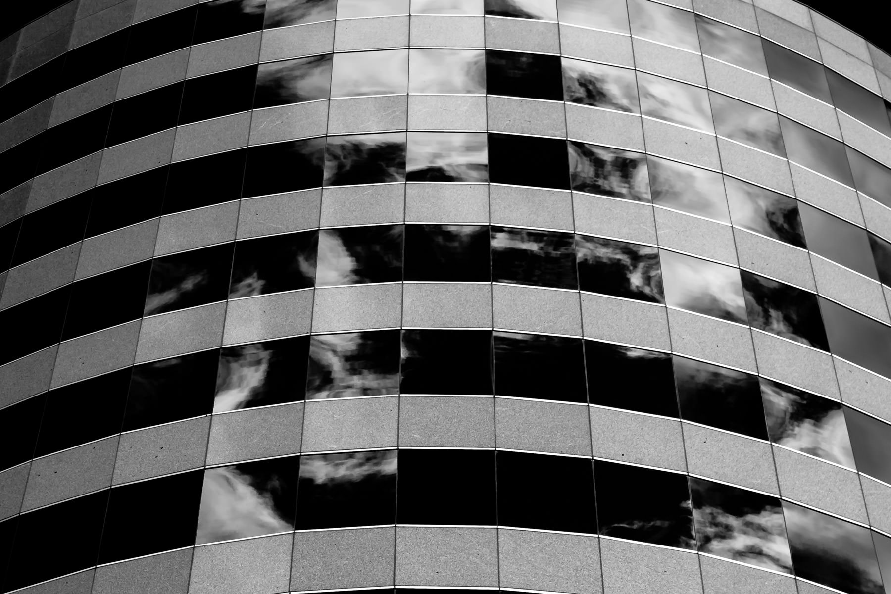 Clouds reflecting off the windows of a Addison, Texas, office building.