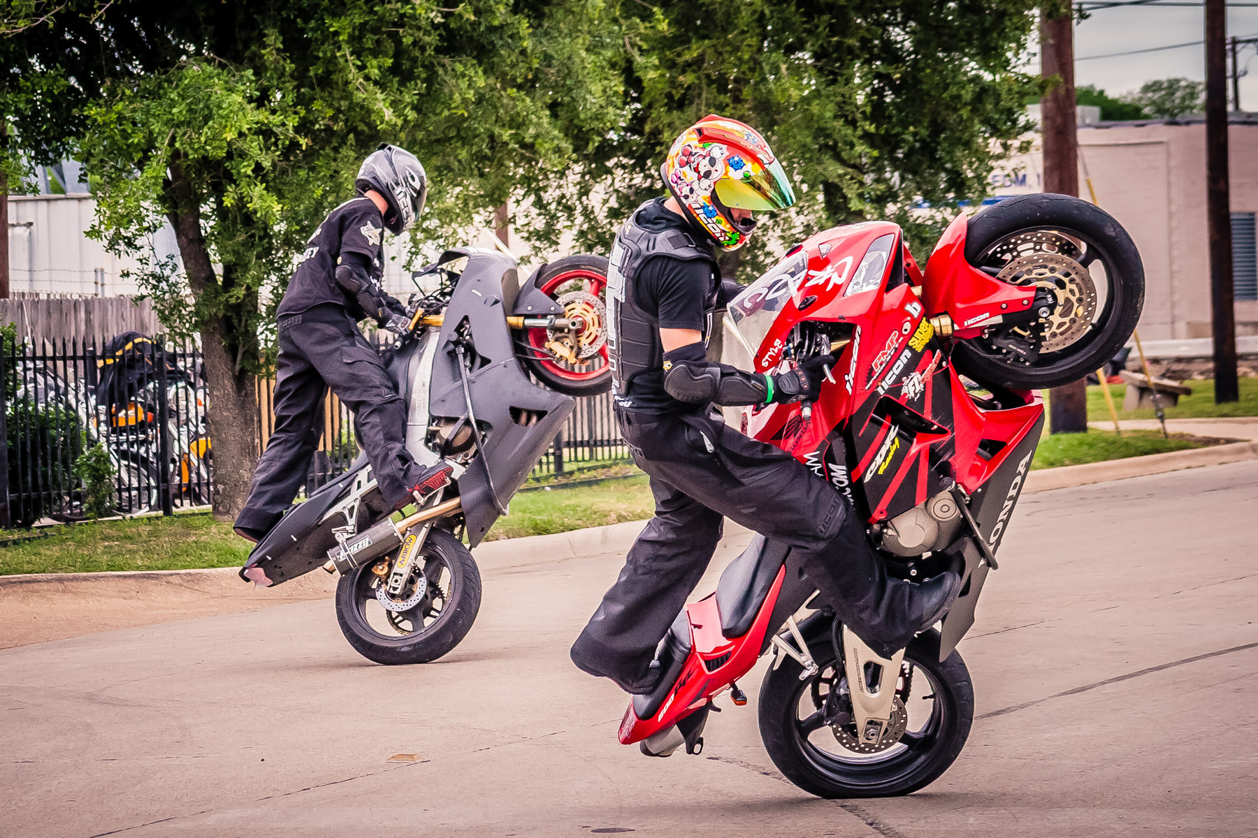 Stunt performers at a Dallas motorcycle shop.