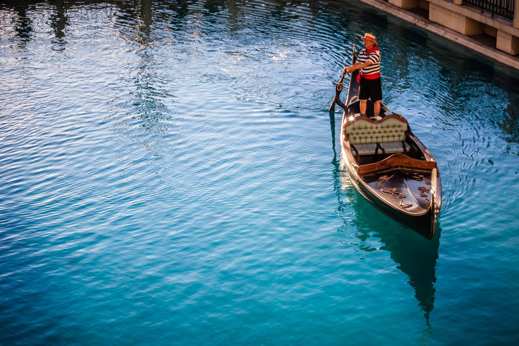 A gondolier steers his gondola at The Venetian, Las Vegas.