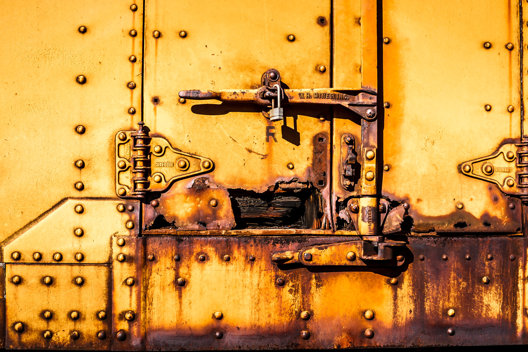 The decaying latch of an old boxcar in Downtown Grapevine, Texas.