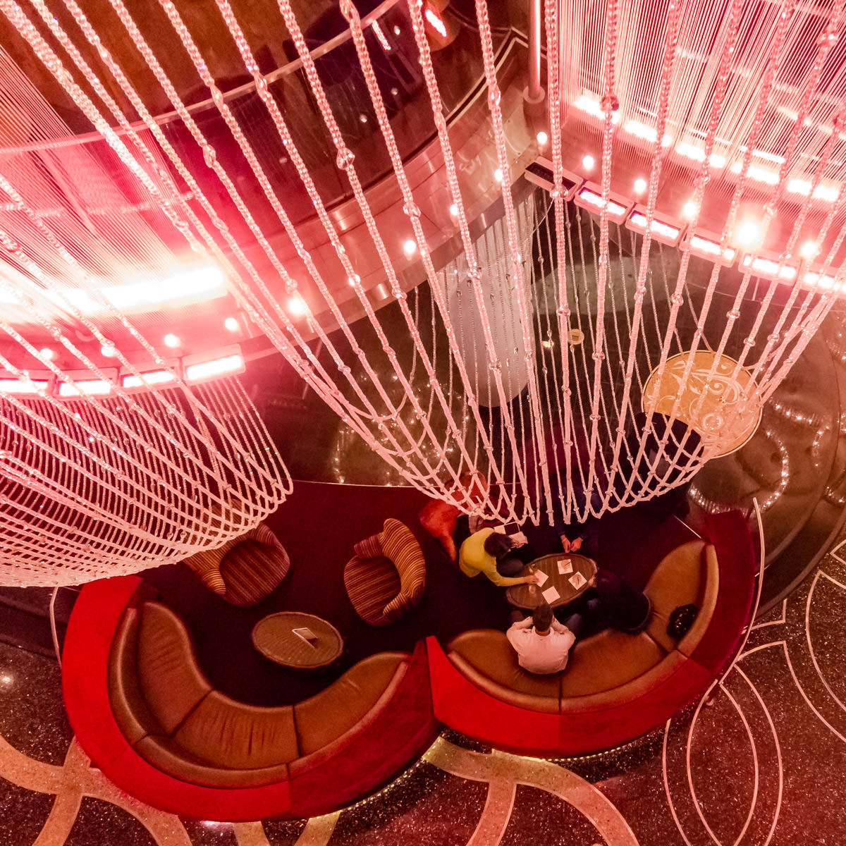 Patrons of The Chandelier Bar at the Cosmopolitan of Las Vegas enjoy drinks on the lowest level of the 65-foot-tall, 2 million crystal chandelier that contains and gives the bar its name.