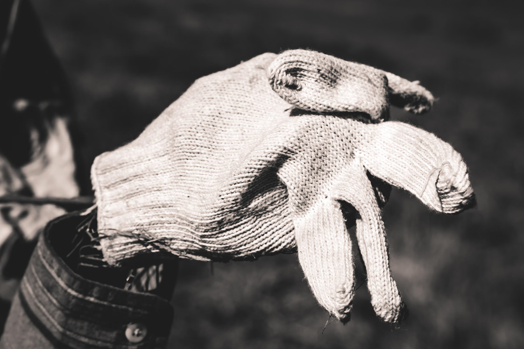An old glove makes up the hand of a scarecrow at Moore Farms in Bullard, Texas.