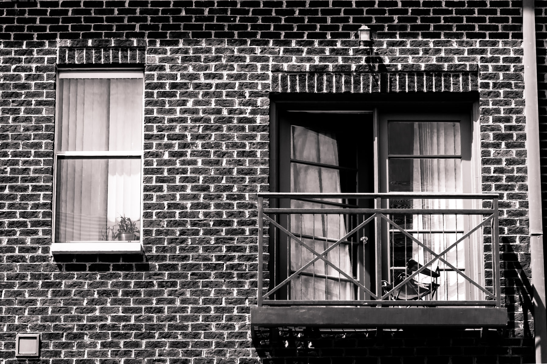 A lonely chair perched on the balcony of an apartment somewhere in the Addison Circle neighborhood of Addison, Texas.