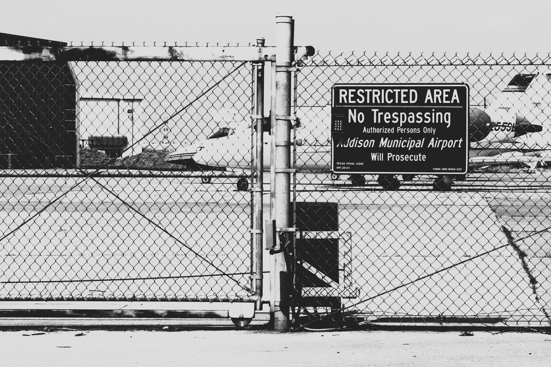 Jets behind a security fence at Addison Airport, Addison, Texas.