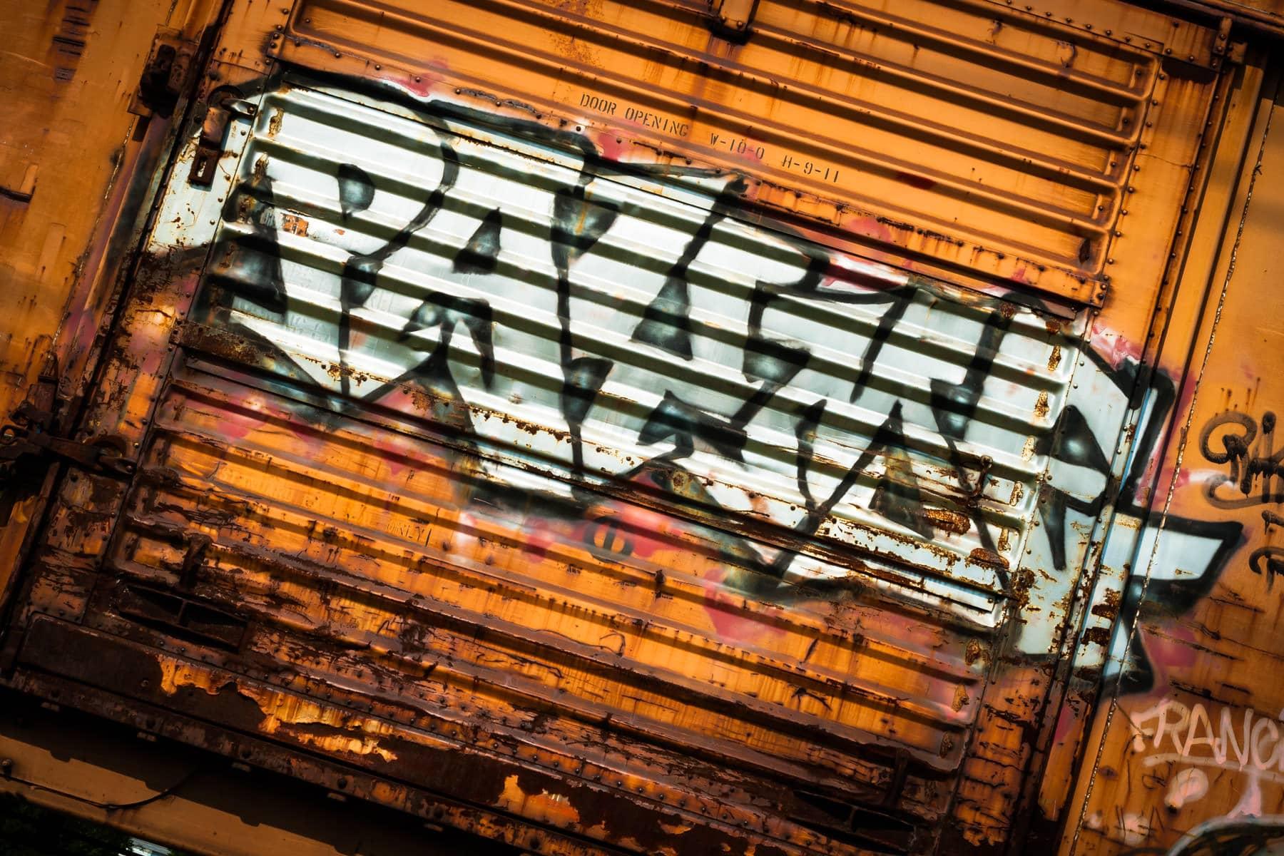 Graffiti on a railroad box car in Farmers Branch, Texas.