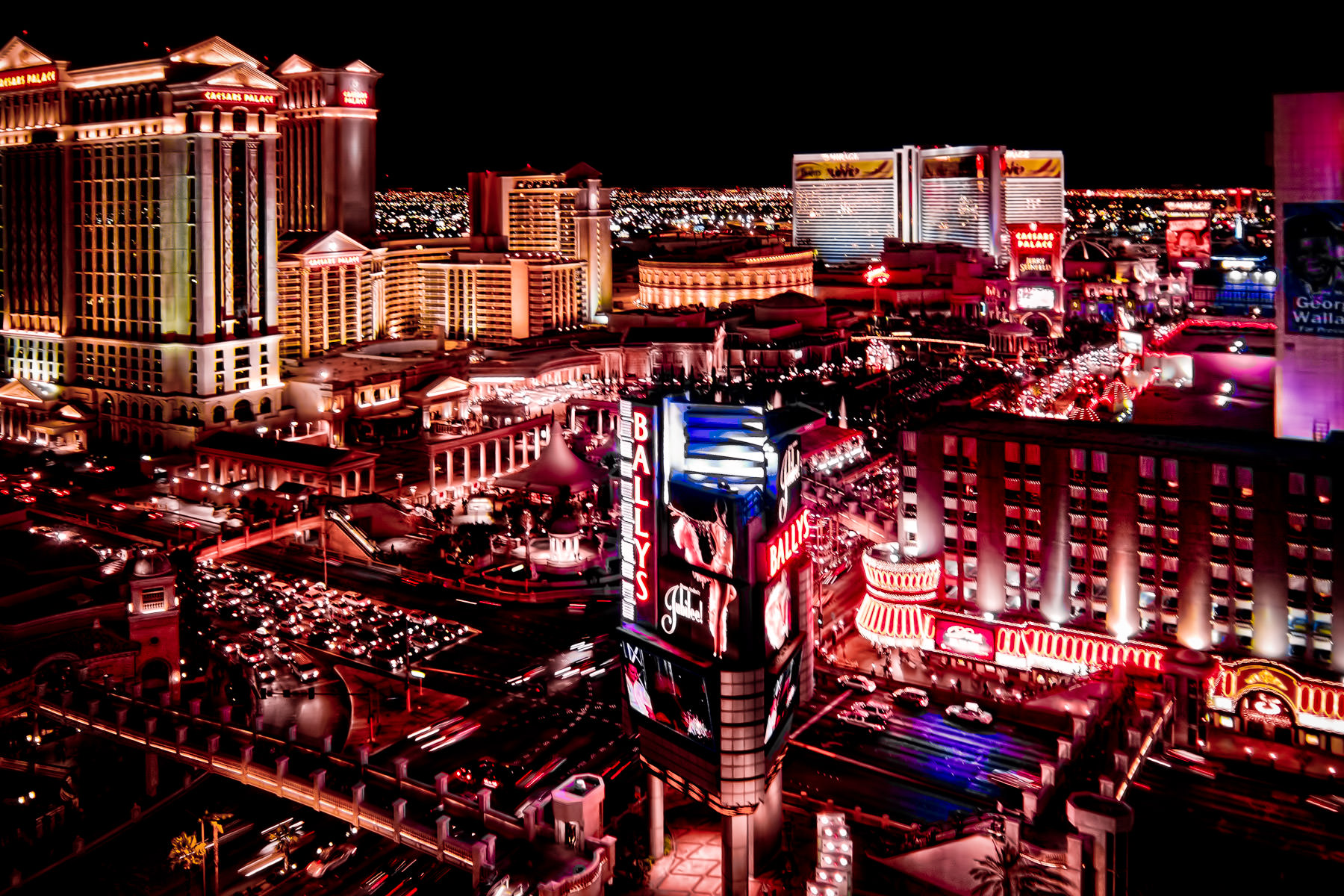 The intersection of Flamingo Road and the Las Vegas Strip (Las Vegas Boulevard) as seen from Ballys at night.