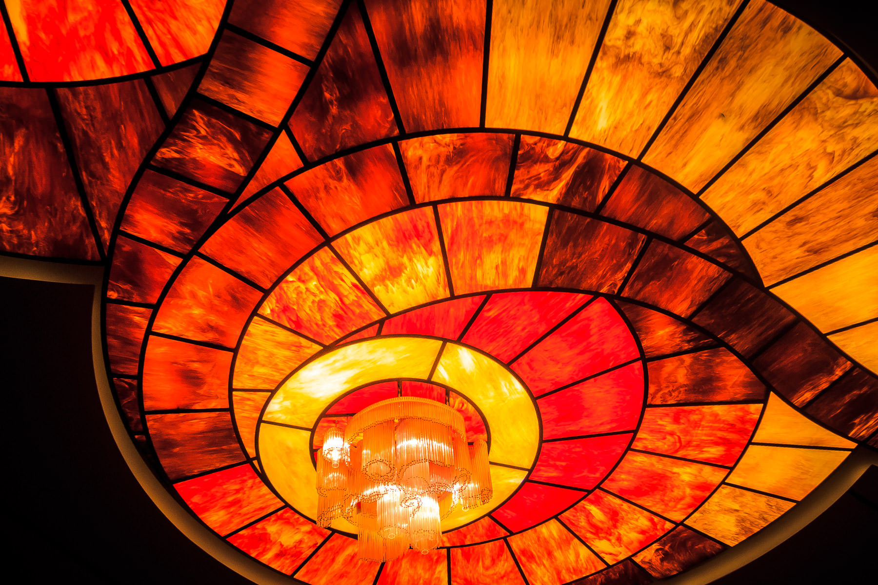 Interior detail of The Cosmopolitan of Las Vegas, featuring a chandelier and its colorful surroundings.