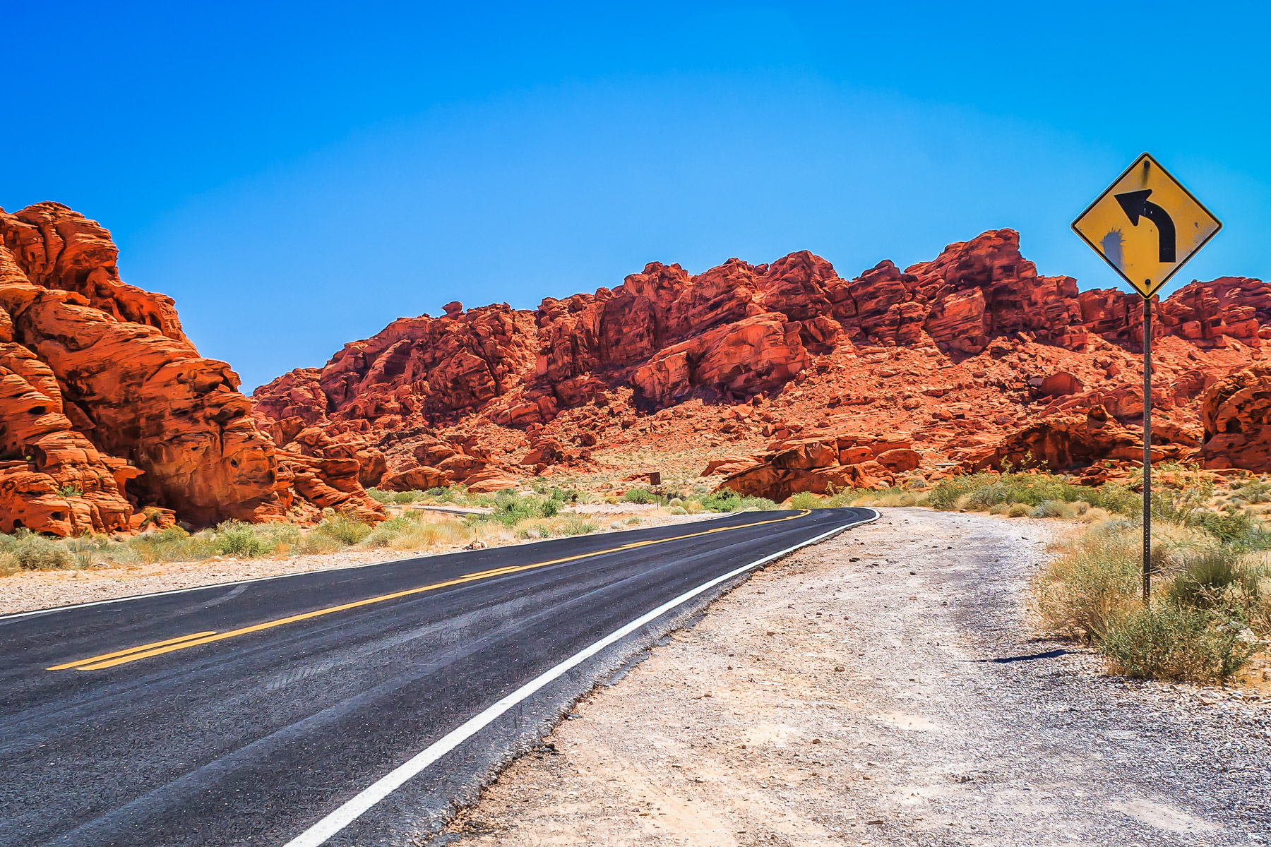 A desert road winds through the rocky landscape of Valley of Fire, Nevada.