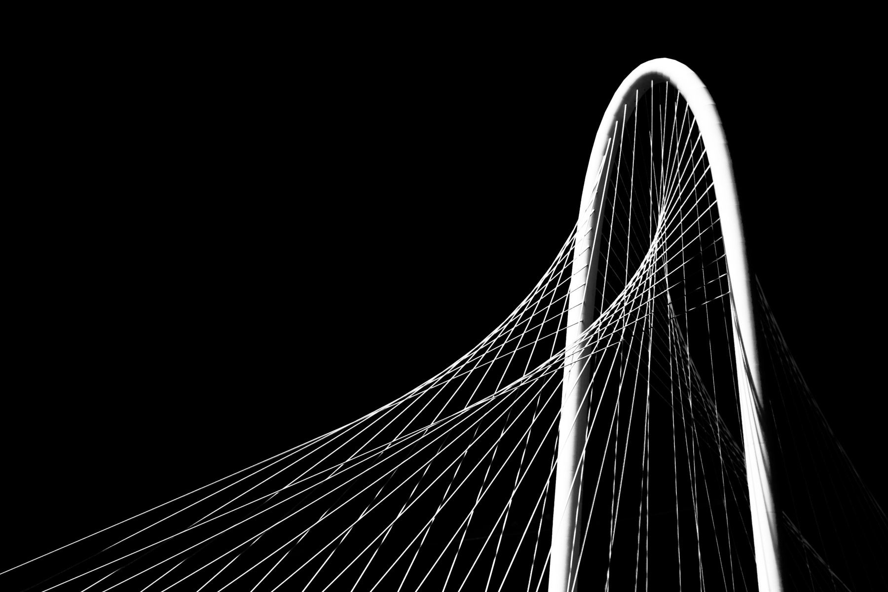 Detail of the main arch and suspension cables of Santiago Calatrava's Margaret Hunt Hill Bridge, Dallas, Texas.