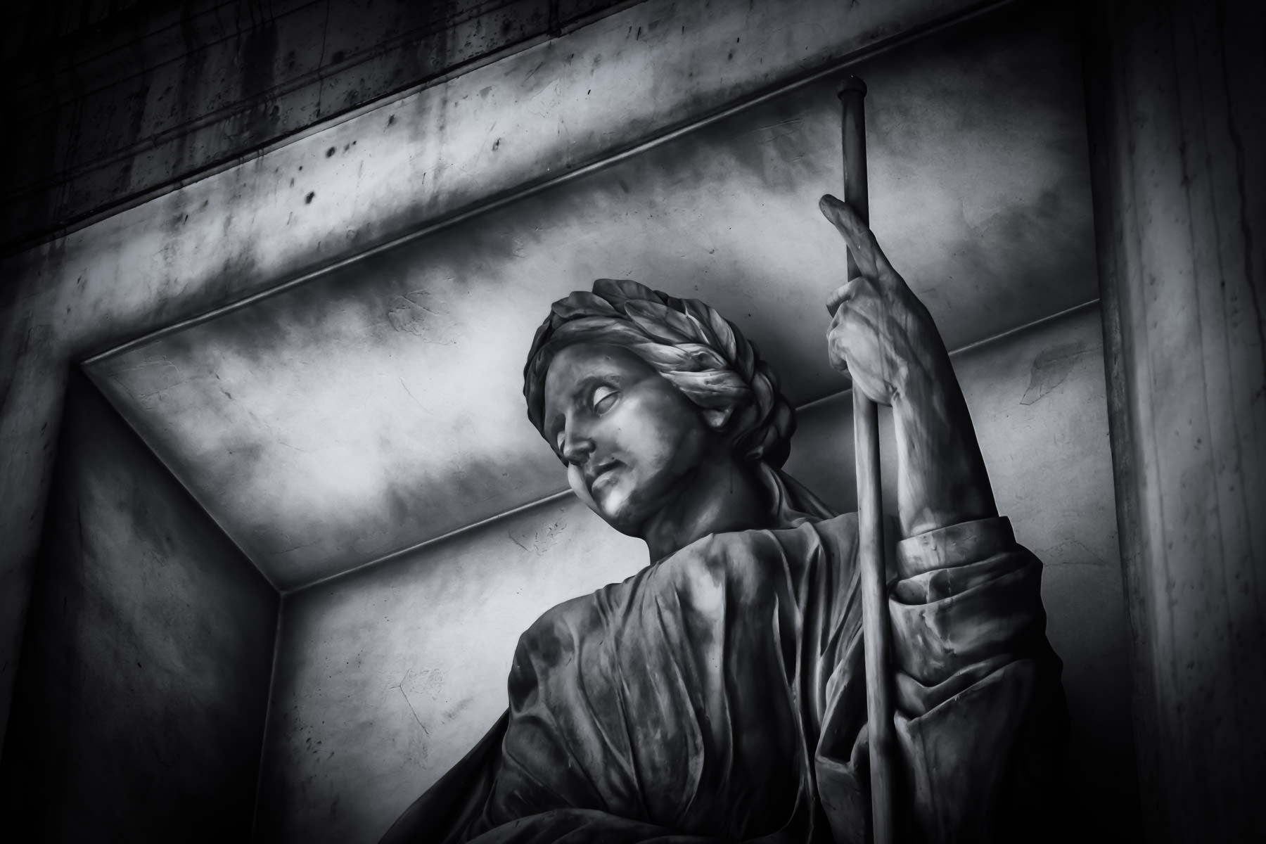 A statue holds a staff at Caesars Palace, Las Vegas.