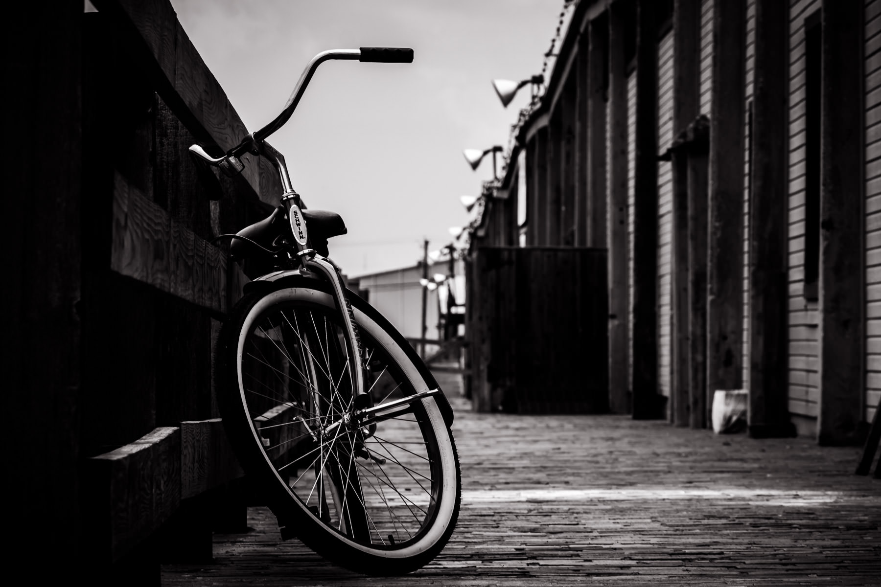 A lonely bicycle leans against a railing in the Fort Worth Stockyards.