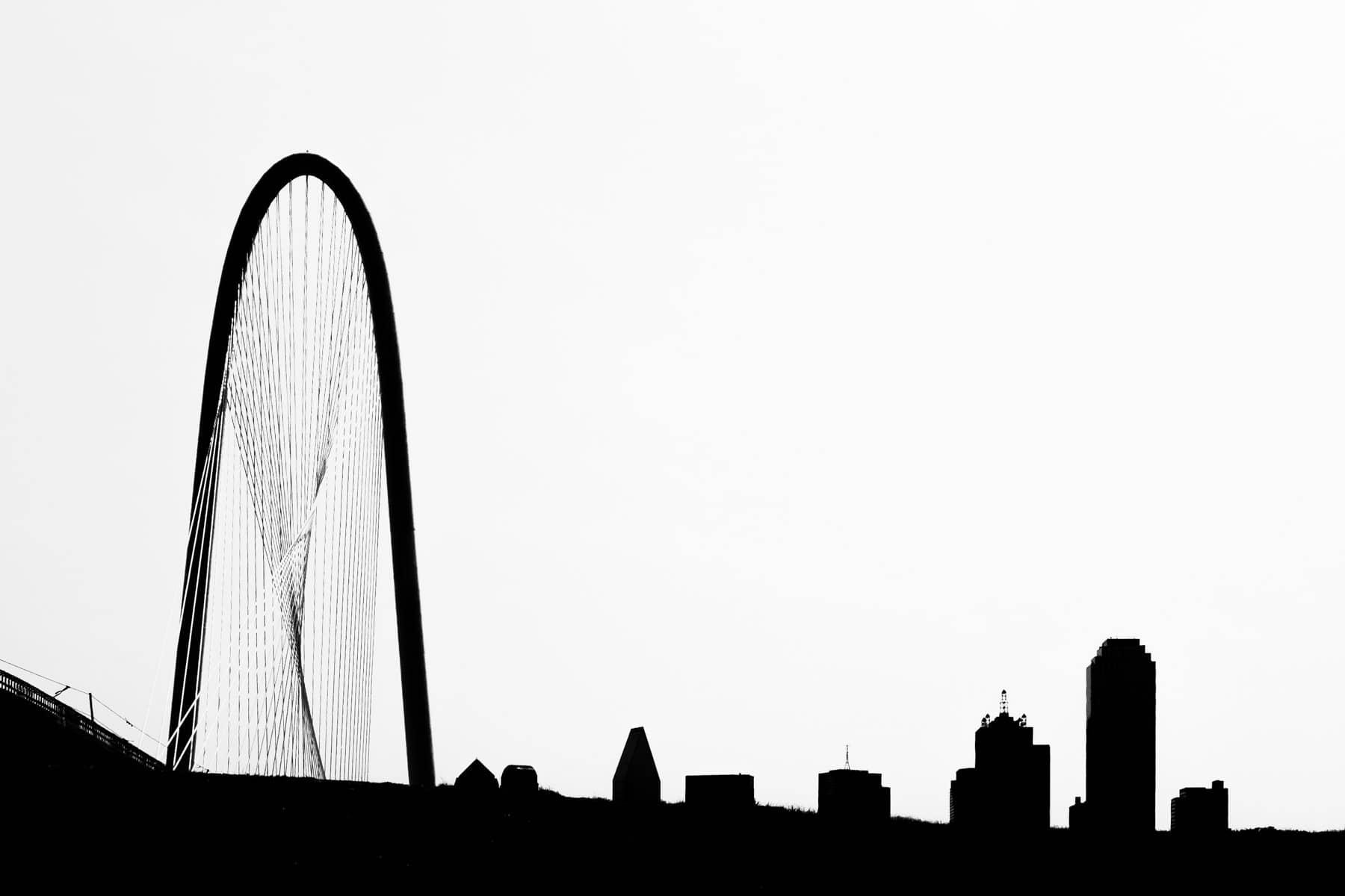 Dallas' Santiago Calatrava-designed Margaret Hunt Hill Bridge rises over the city's skyline.