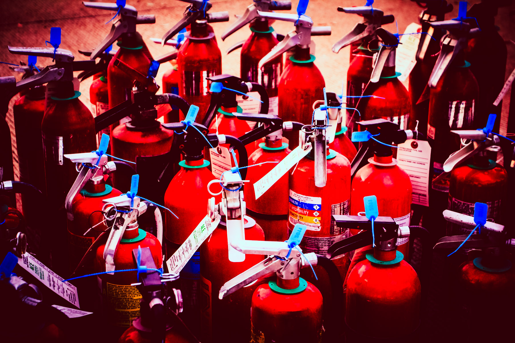 Fire extinguishers ready for strategic distribution around Addison Circle Park in Addison, Texas, for Oktoberfest safety.