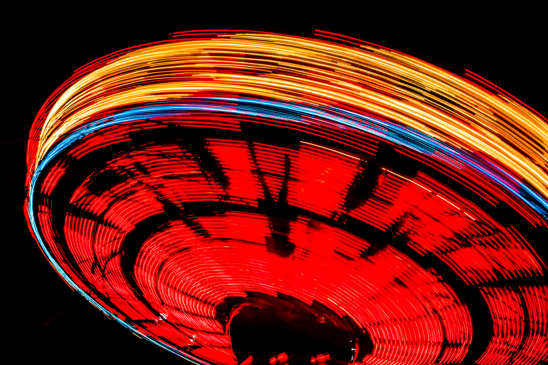 A long exposure shot of a carnival ride at Addison Oktoberfest, Addison, Texas.