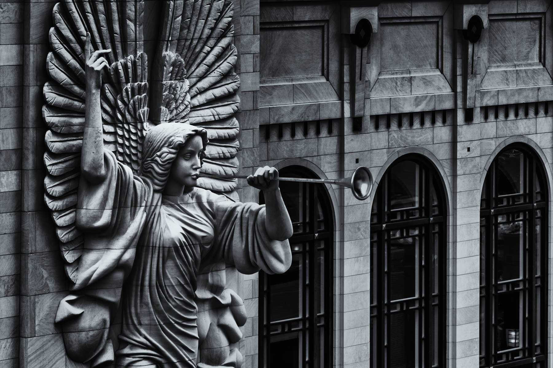 One of two 48-foot-tall trumpet-playing angels on the façade of Fort Worth's Bass Performance Hall seem to announce the presence of this opera house to the world.