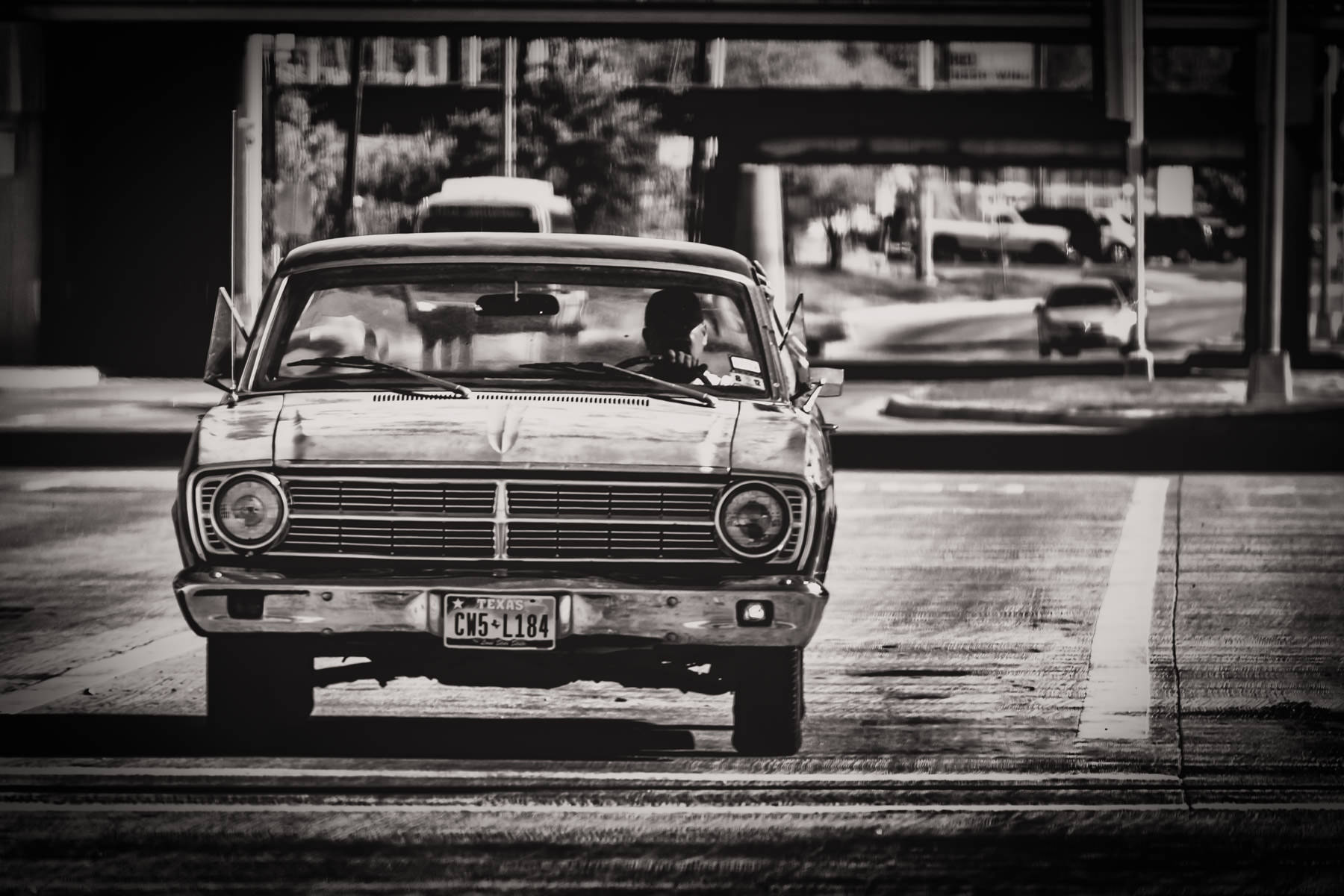 Driving a classic car in Dallas at I-35 and Inwood.