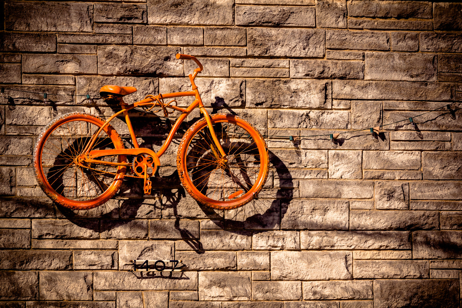 A bicycle as artwork on the side of a custom bike shop in The Cedars, Dallas, Texas.