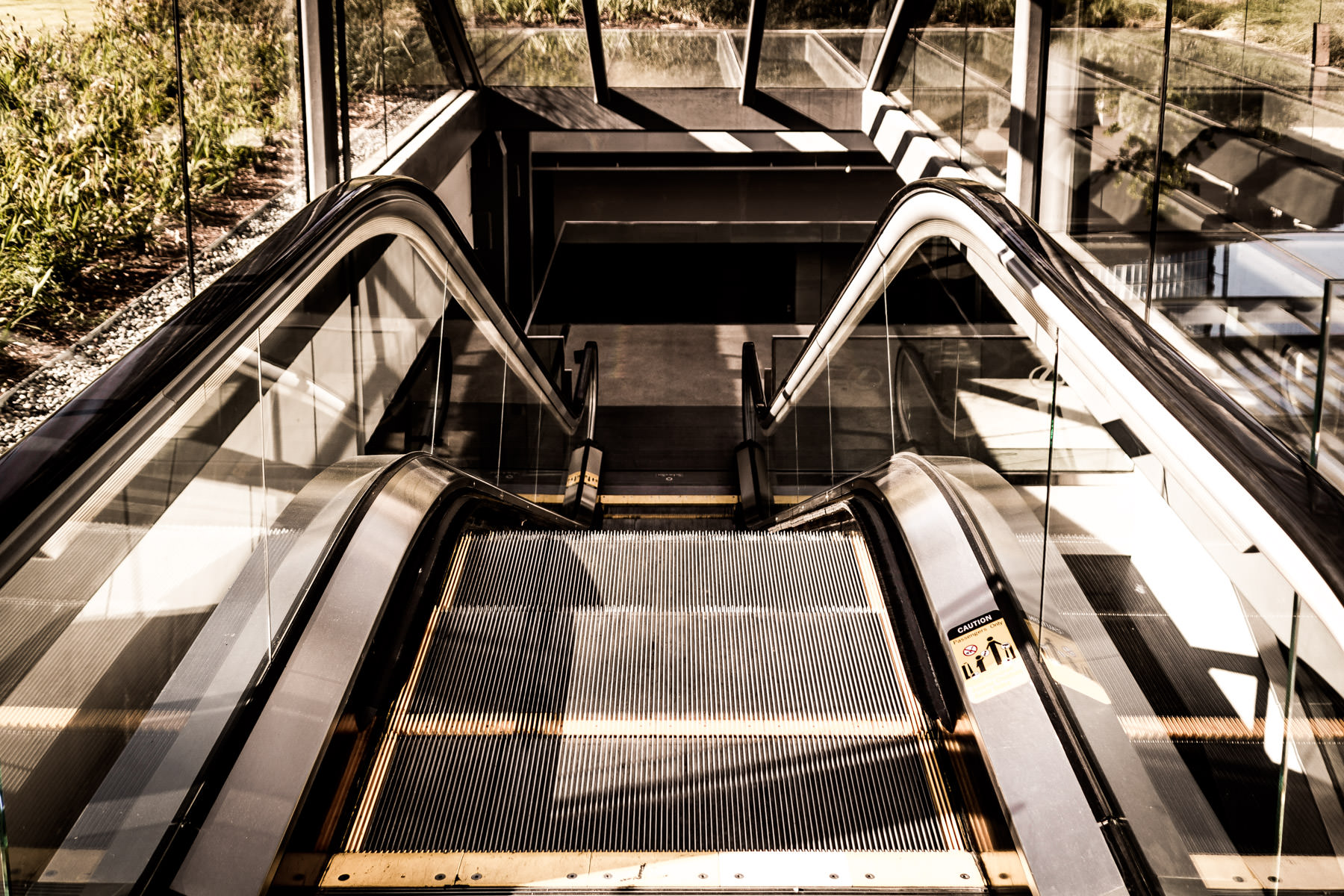 An escalator leading to an underground parking garage at the AT&T Performing Arts Center, Dallas.