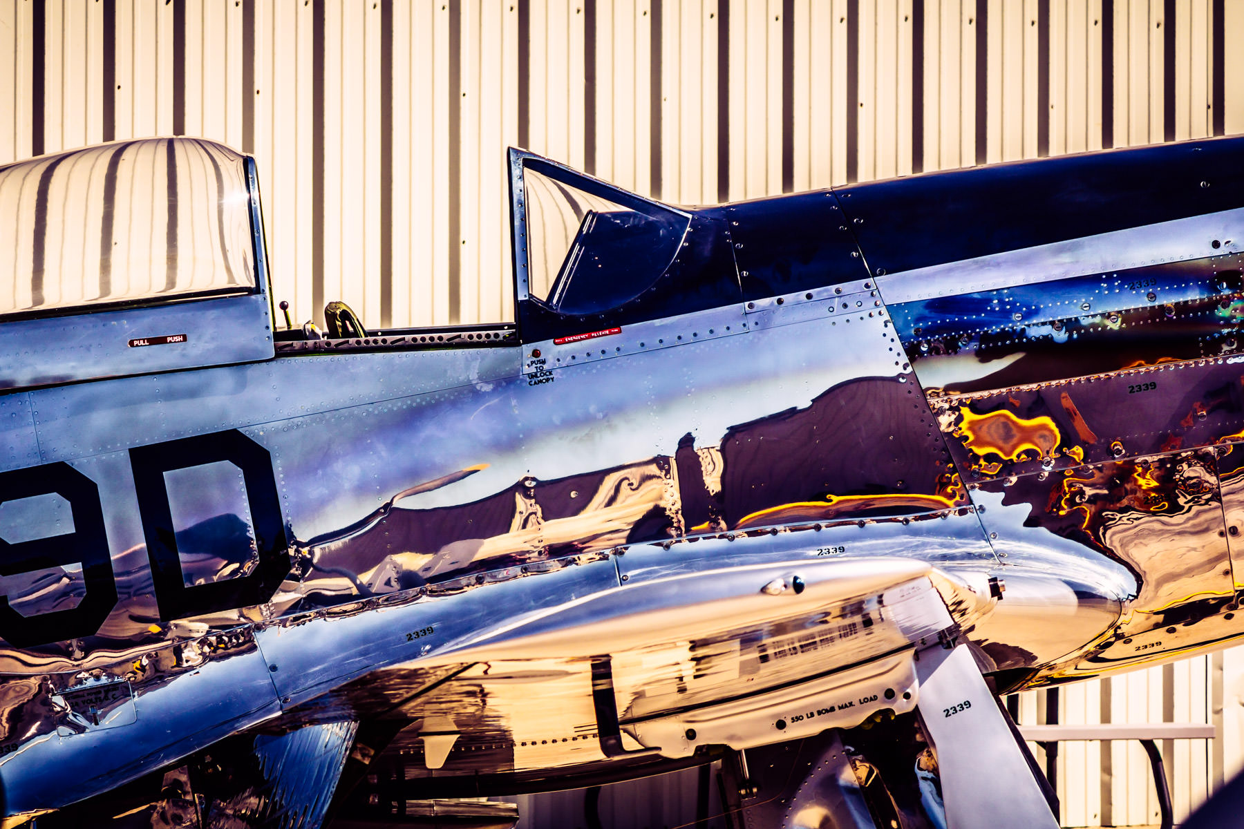 A classic airplane reflects its surroundings in its chrome skin at the Cavanaugh Flight Museum, Addison, Texas.