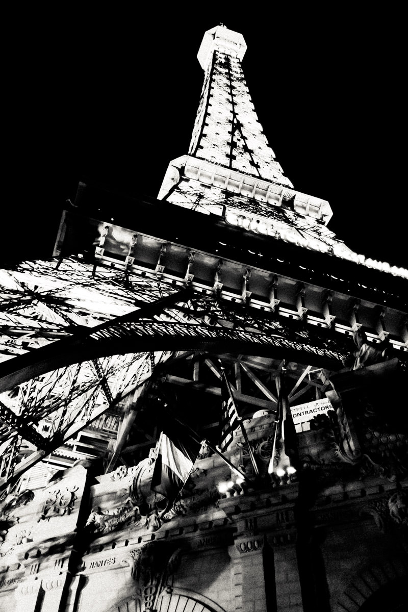The ersatz Eiffel Tower at Paris Hotel & Casino rises into the night sky of the Las Vegas Valley.