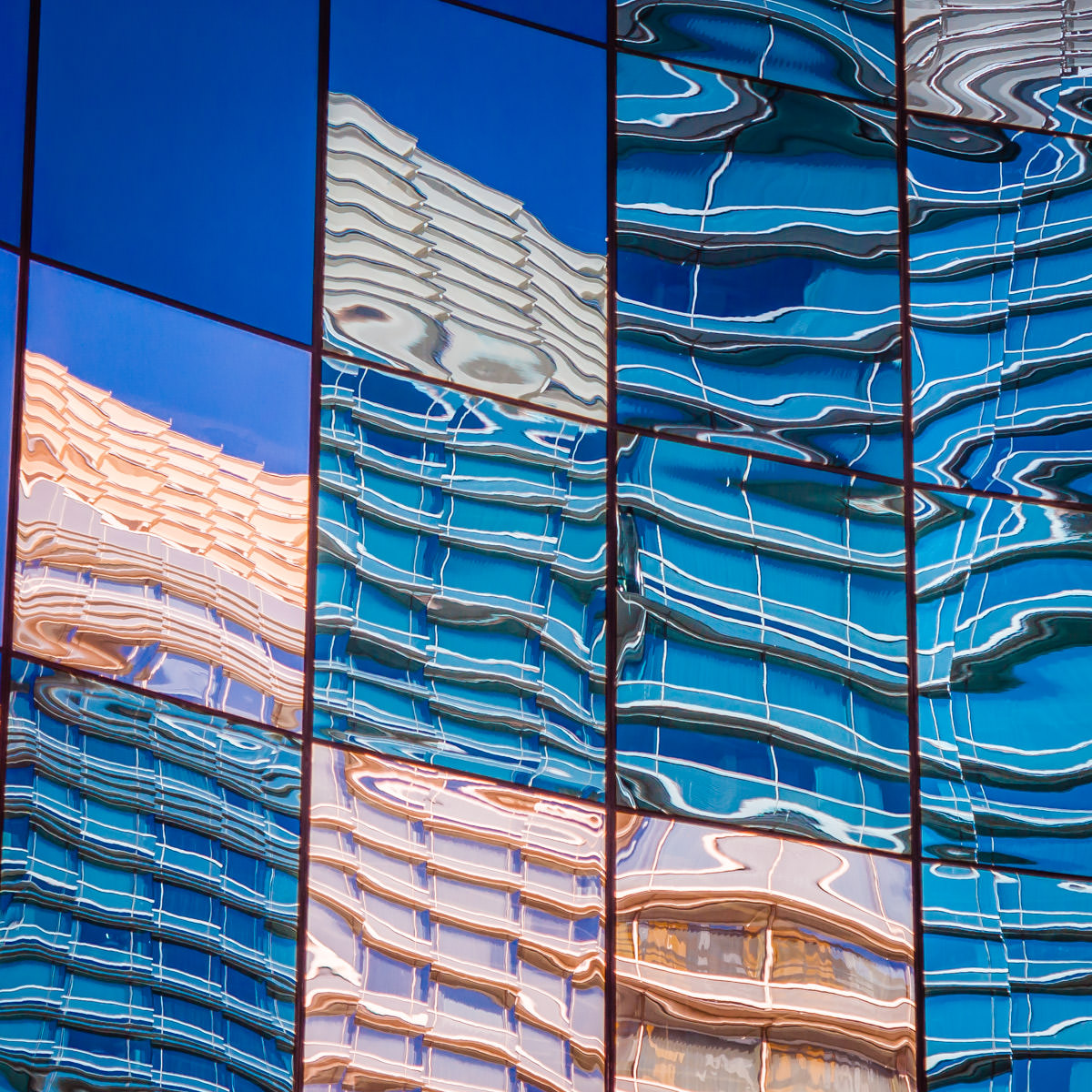 Las Vegas' Aria is reflected in the mirrored-glass exterior of the never-opened Harmon Hotel at CityCenter.