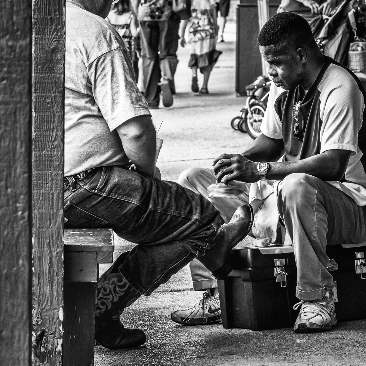 A tourist gets his boots shined at the Fort Worth Stockyards, Texas.