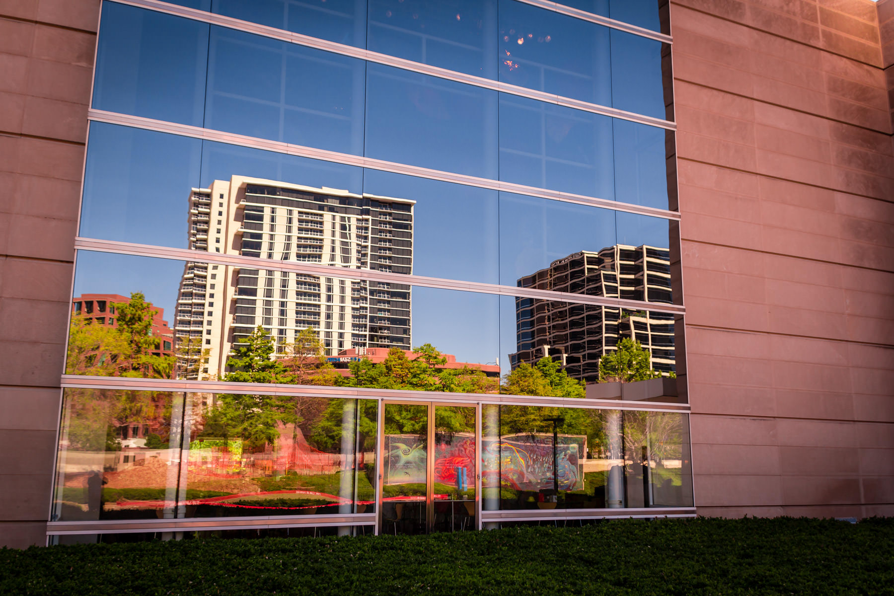 Buildings in Uptown Dallas reflected in windows of the Dallas Museum of Art.