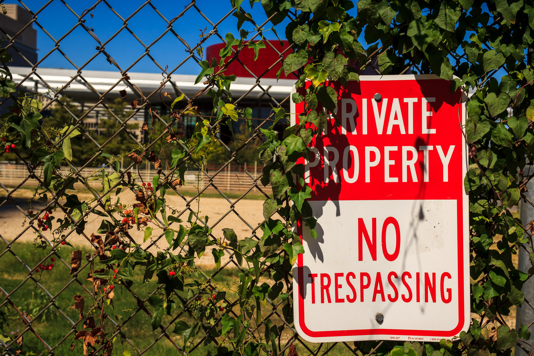 A fenced-off lot in the Dallas Arts District, behind which can be seen the Winspear Opera House.