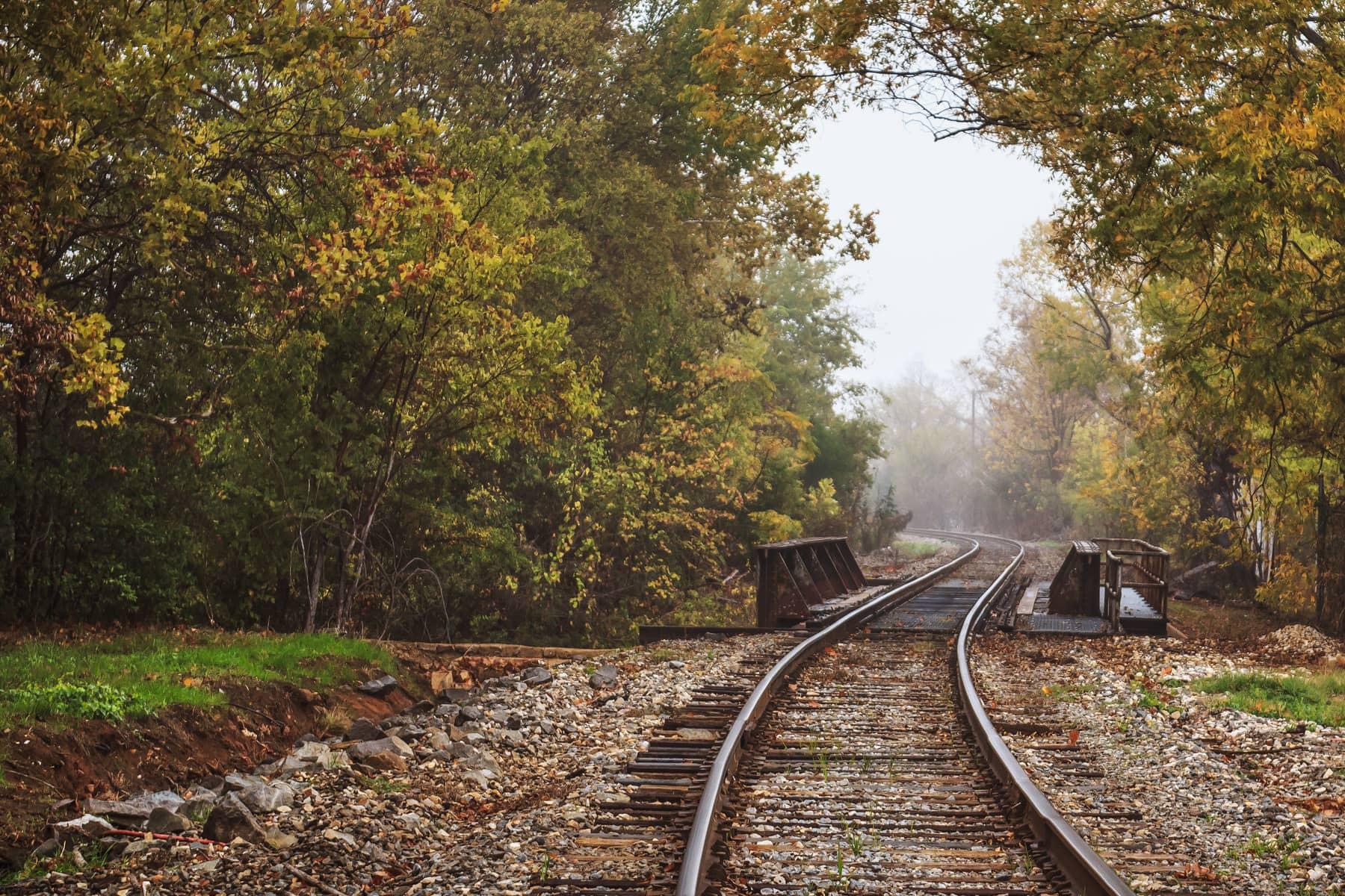 Train tracks lead through the fog near Downtown Tyler, Texas.