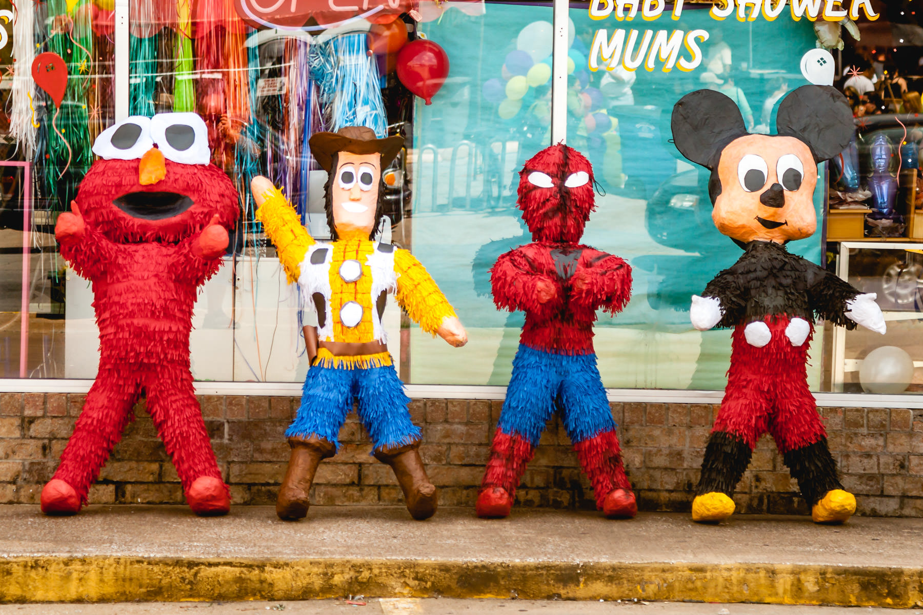 Piñatas depicting Elmo, Woody, Spiderman and Mickey Mouse spotted outside a shop in Oak Cliff, Dallas.