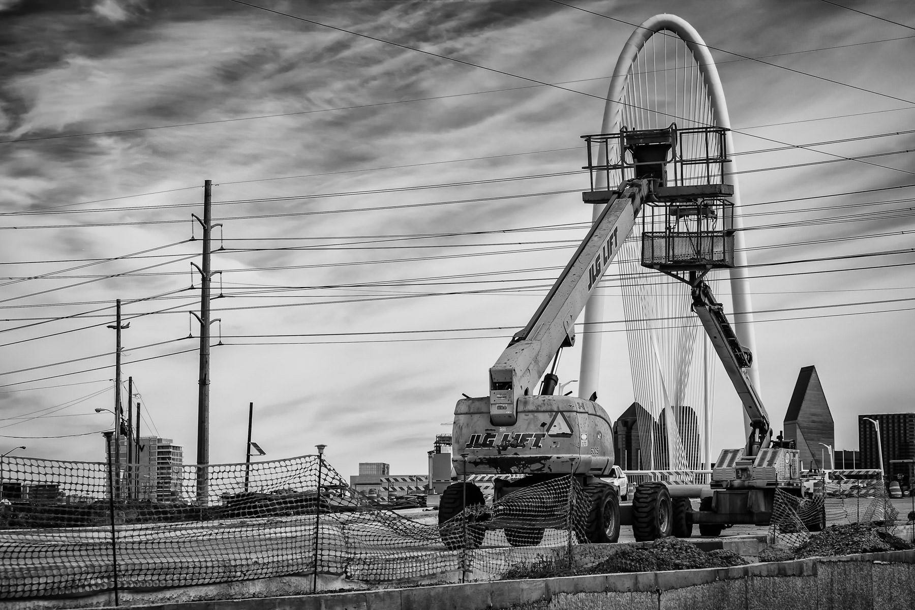 Man lifts and the Margaret Hunt Hill Bridge, Dallas.