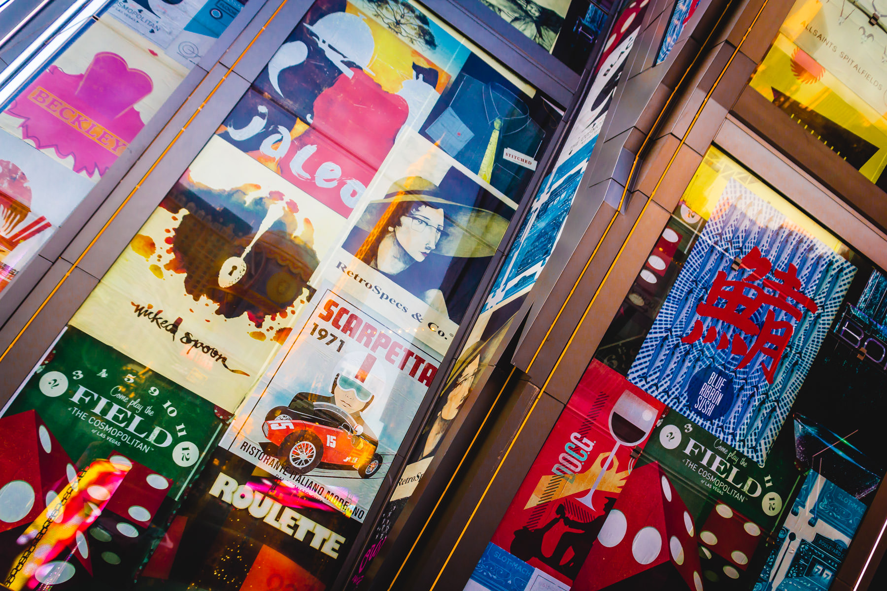 Old travel and entertainment posters in windows at The Cosmopolitan of Las Vegas.